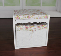 small wooden storage cabinet with handmade wicker basket
