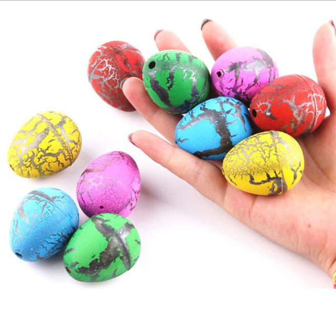 Novelty Dinosaur Egg Magic Hatching Growing Dinosaur Toys 2*3cm dinosaur fossils eggs for sale