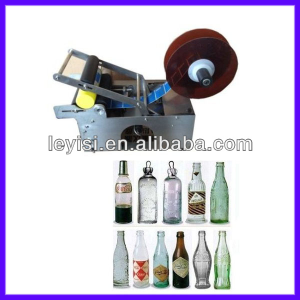 Small industry manual semi automatic water round bottle labeling machine