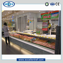 cooler counter with open topside used as display case for fresh/chilled meat in supermarket