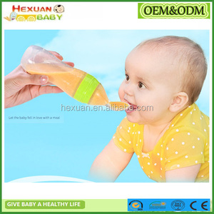 baby feeding bottle with spoon/squeeze feeder/Baby Silicone Squeeze Spoon