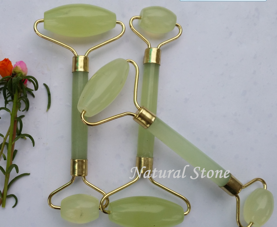 woman handheld face care products natural jade massager roller