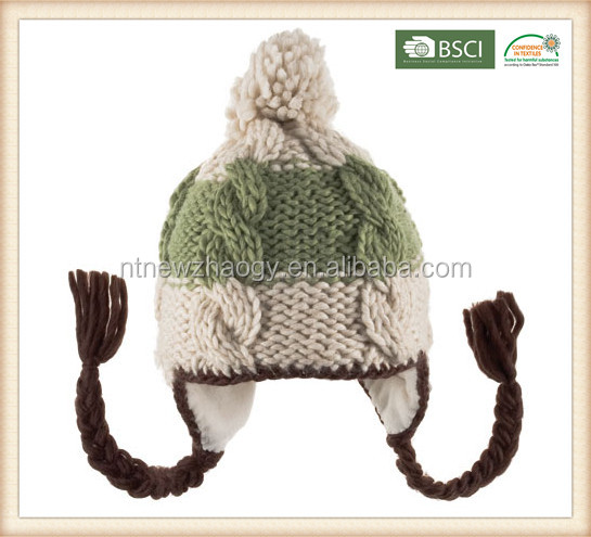 Fashion machine cable jacquard earflap hat with large pompoms and braids