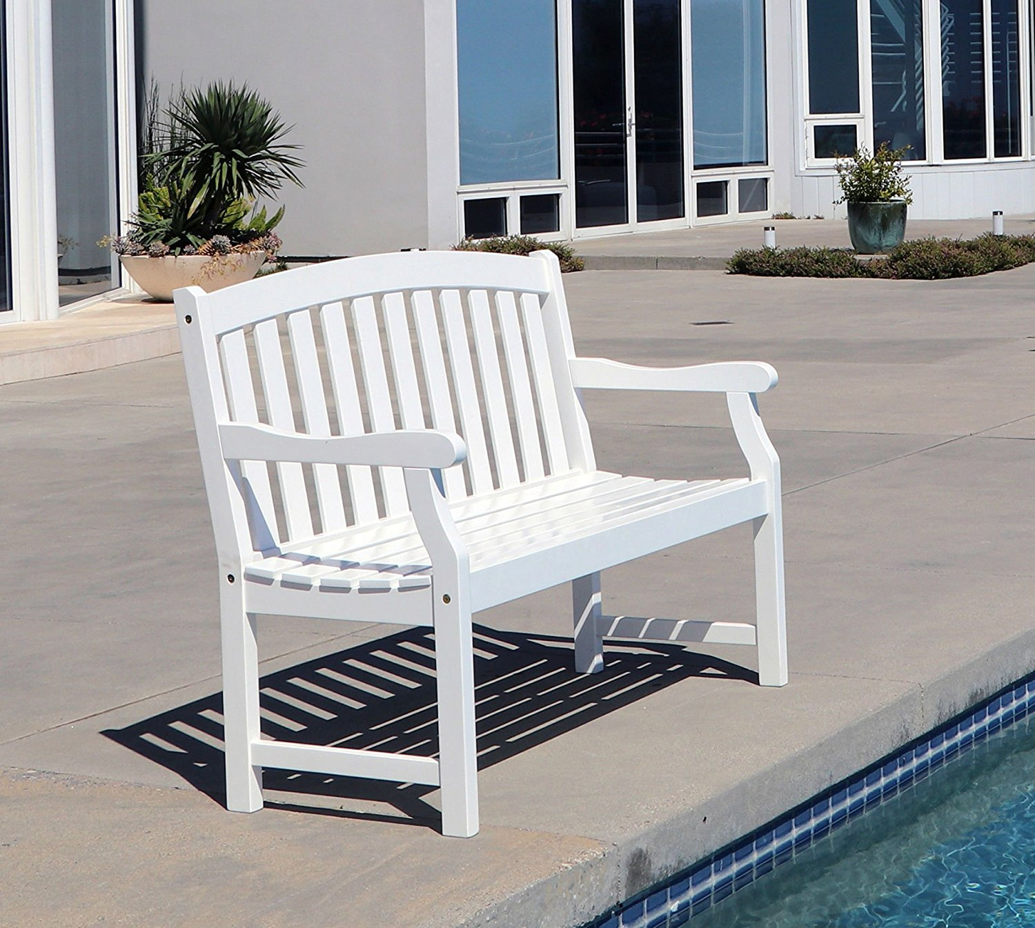 This White Wood Garden Bench features a classic weather resistant finish. This 2 seater is a great outdoor patio furniture piece. Perfect poolside or in any space, porch, patio or outside living area