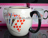 embossed porcelain cup with playing cards pattern