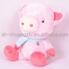 stuffed pink pig toy with scarf