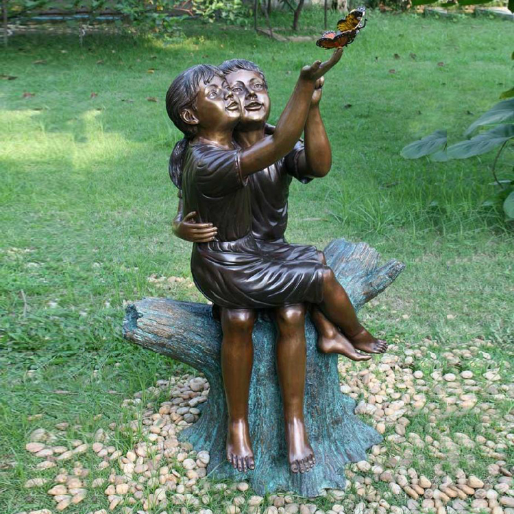 Bronze children and butterfly sculpture Life size children sat on stump to see butterfly statue