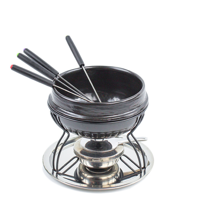 Round shape black color glazed thickness mini chocolate cheese fondue with forks