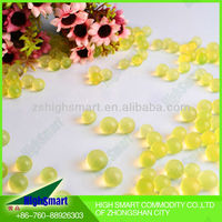 Yellow and golden aqua gel beads for fresh flower arrangements