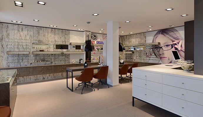 Branded eyewear retail shop wood display counter and glass shelving for sunglasses display