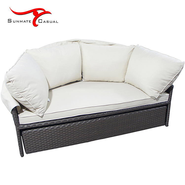 rattan daybed with pillow.jpg