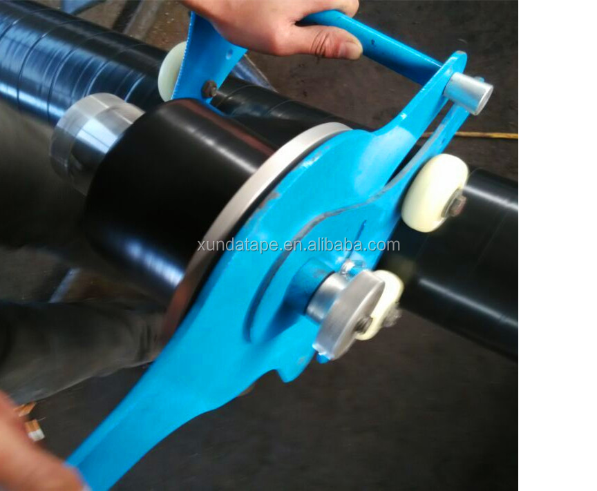 Hand applied cold applied tape wrapping machine