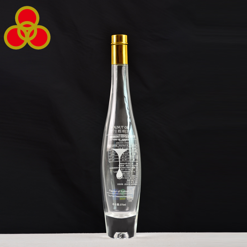Decal surface dealing empty 375ml glass bottle for spirits