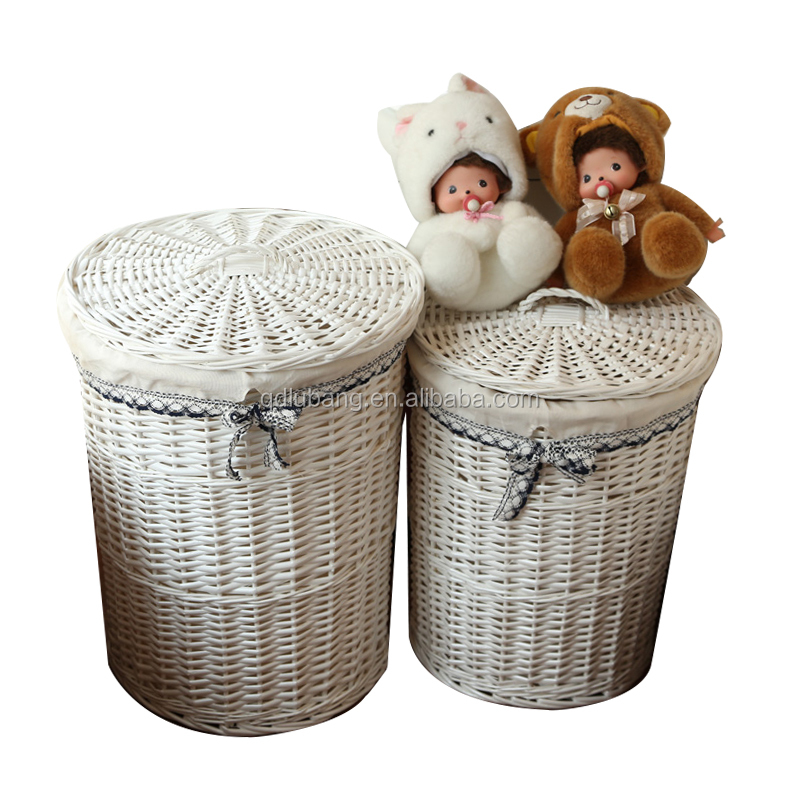 White round handmade fabric lined wicker toy storage basket with handle