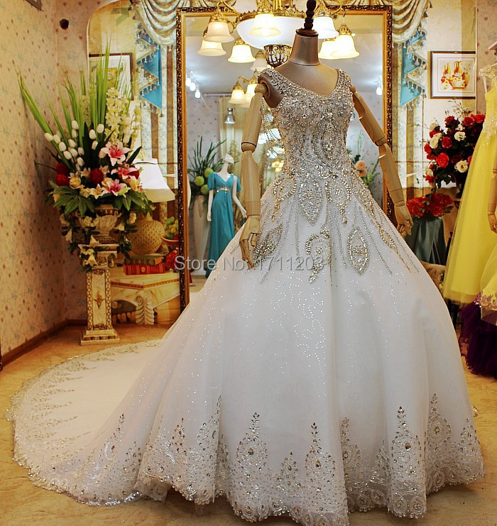 33ada1785 Amazing Luxury Crystal Beading Bridal Wedding Dresses 2015 Custom Made  Backless Spaghetti Strap Sexy Royal Princess Wedding Gown