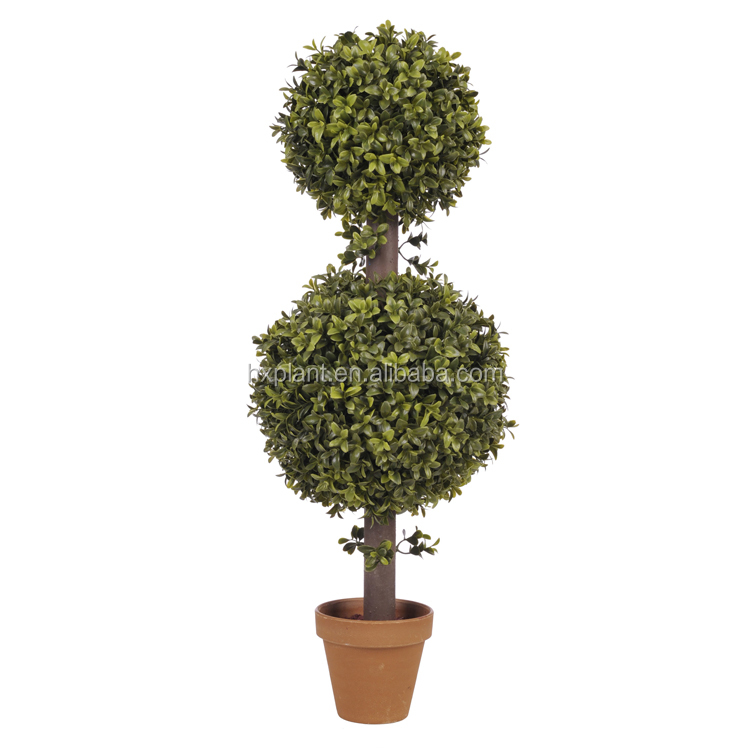 artificial topiary ball plant of grass plant boxwood with flower pot