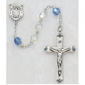 Light Blue and Crystal Glass Catholic Rosary Beads - This Elegant Rosary has 7mm Blue and Crystal Aurora Borealis Glass Rosary Beads with a Sterling Silver Crucifix and a Sterling Silver Miraculous Medal Centerpiece. The Rosary comes packaged in a Deluxe Gift Box.