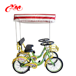 Blue and yellow color bike on road/2 person cycling for fun/rental park bicycle
