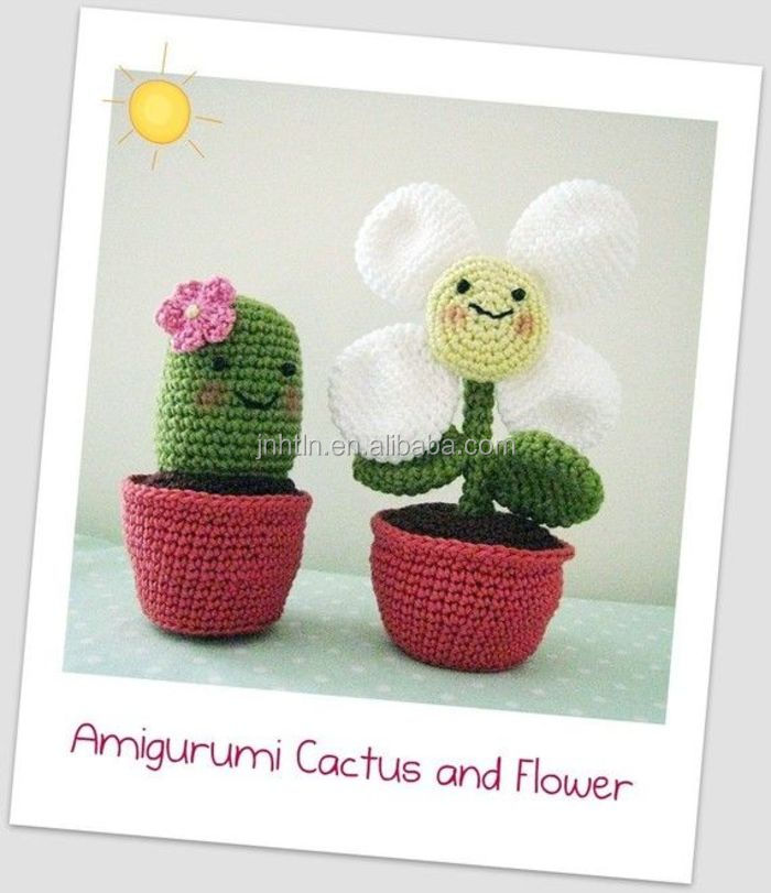colored handmade crocheted flowers with clay pot