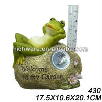 frog welcome sign with garden solar lighting