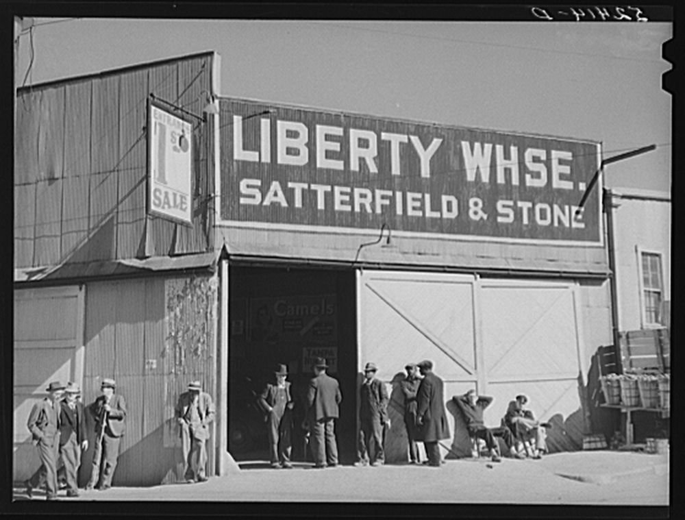 1939 Photo Outside tobacco warehouse during auction sale. Durham, North Carolina Location: Durham, Durham County, North Carolina