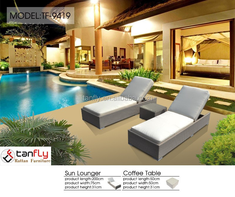 comfortable double seater hotel pool lounge with side table