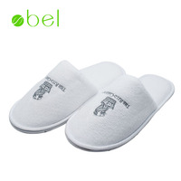 Top selling 5 star white closed toe disposable hotel slippers personalized logo velvet cotton guest slipper for Ritz-Carlton