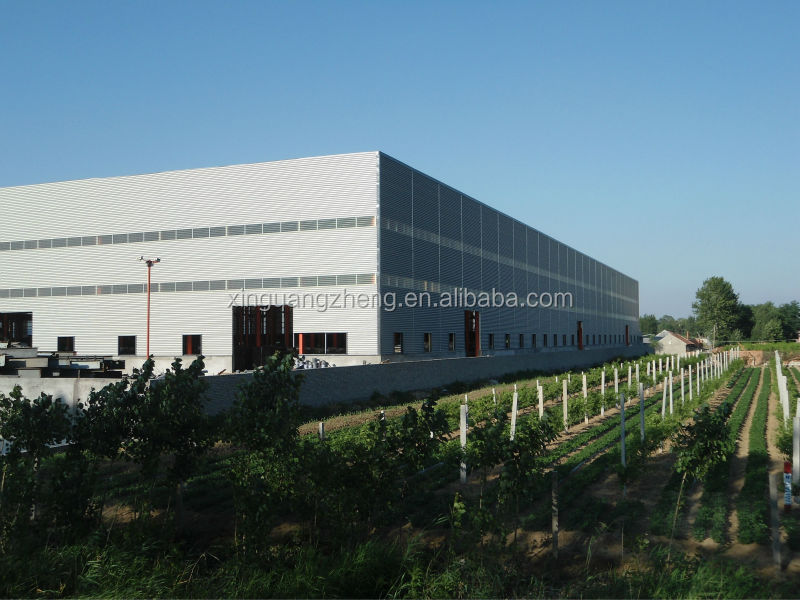 multi story structural steel industrial warehouse with crane