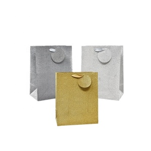 Wholesale custom heavy duty shopping wrapping gold silver glitter paper gift bags with ribbon handles
