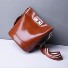 2019 new European and American fan wild fashion women's bag oil wax leather bucket bag hand strap shoulder Messenger bag