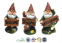 Resin with welcome antique garden gnomes