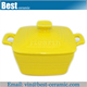 yellow glazed ceramic casserole dish with lid