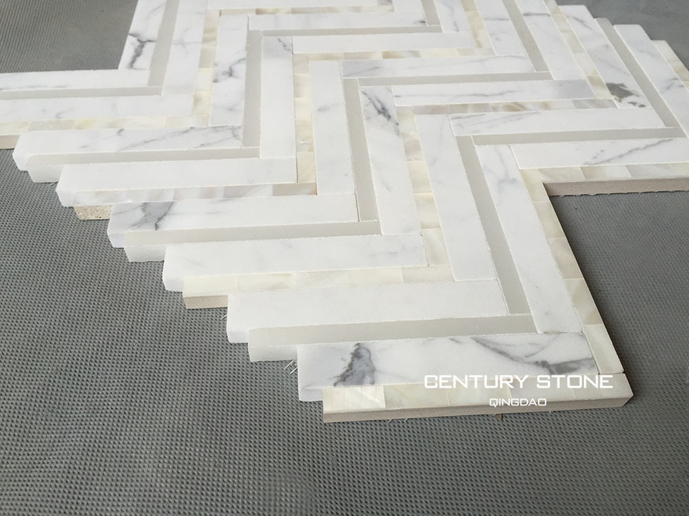Calacatta Marble And Seashell Herringbone Backsplash White