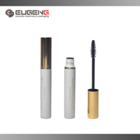 white empty mascara packaging with brush