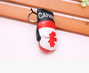 Wholesale hot item PVC mini boxing glove keychains with national flag or football club logo boxing glove keychains