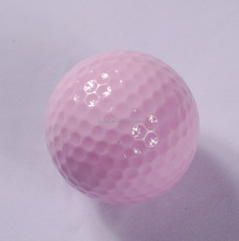 Crazy pink colored driving range golf balls