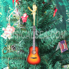 Miniature guitar and wooden christmas decoration