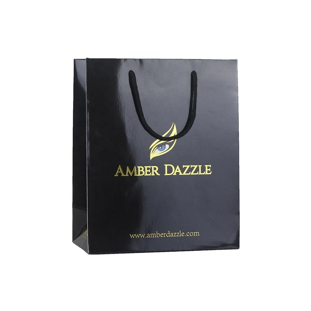 中国工場高級黒と金の化粧キャリー包装化粧品紙のギフトショッピングバッグ