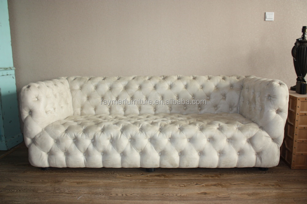 White Fabric On Tufted Chesterfield Sofa