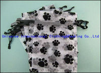 Sheer black and white paw print gift organza bags