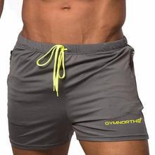 Новая мода Для мужчин шорты сжатия быстро сохнет Бодибилдинг штаны Фитнес BeachShorts Jogger Повседневное тренажерные залы тонкий Для мужчин шорты(Китай)