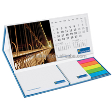 Hard back cover with a desk calendar and a series of sticky notes