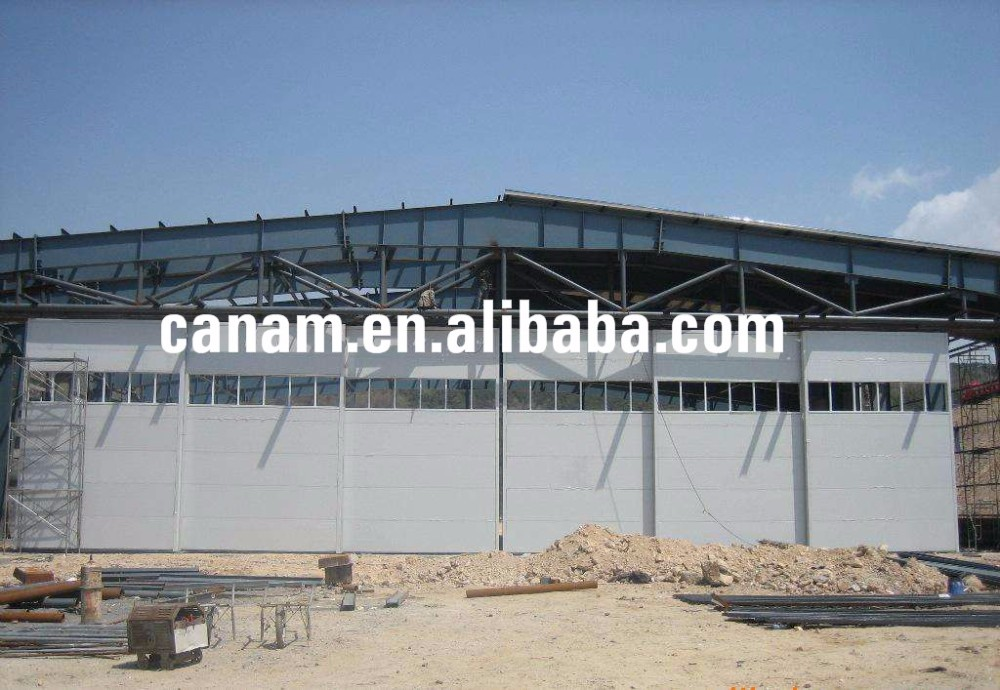 Aircraft hangar shelter construction houses