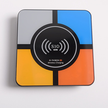 QI Wireless charging RK3328 <span class=keywords><strong>Quad</strong></span> Core Smart TV Box als drahtlose energienbank-ladegerät