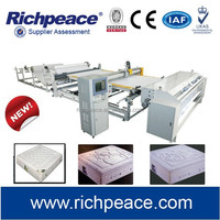 Computerized mattress making machine with feeding spreading clamping quilting and cutting automatically