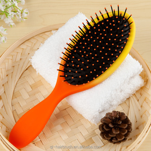 Rubberized Detangle hair brush with spray pump