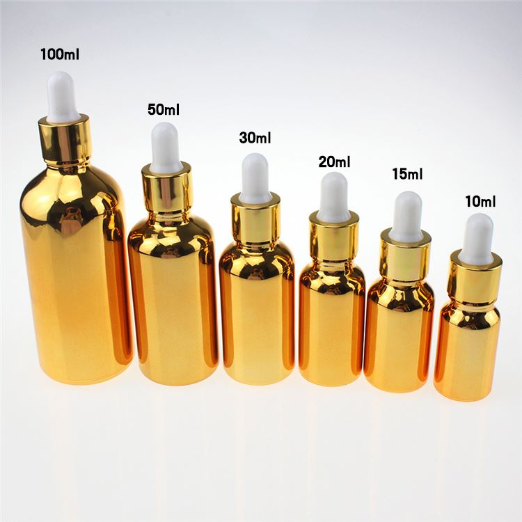 Wholesale gold 100ml large glass essential oil dropper <strong>bottles</strong> , <strong>empty</strong> golden <strong>Perfume</strong> <strong>Bottle</strong> with Dropper