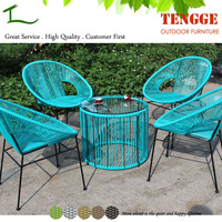 Turquoise color small round rattan acapulco chair and table
