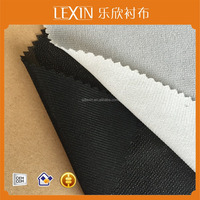 100% polyester woven double dot PA/PES Warp Knitted interlining