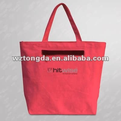 red laminated canvas bag